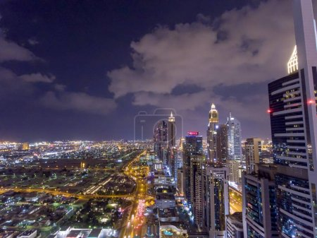 Photo for Night aerial view of Dubai Downtown skyscrapers, United Arab Emirates. - Royalty Free Image