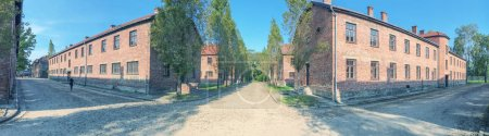 AUSCHWITZ, POLAND - OCTOBER 1, 2017: Buildings of concentration camp at Auschwitz Birkenau, panoramic view. This is a memory of World War II.