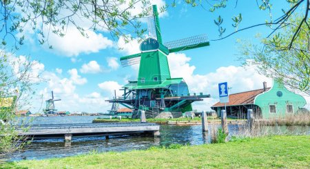 Zaanse Schans, Holland. Classic windmill with canal and trees.