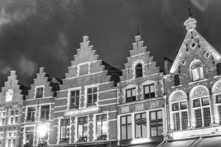 Buildings along the main square of Brugge at night, Belgium.