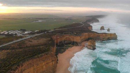Overhead aerial panoramic view of Twelve Apostles on a cloudy sunrise, Australia.