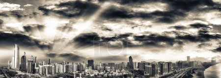 Photo for Abu Dhabi aerial skyline, panoramic view from drone at dusk, UAE. - Royalty Free Image
