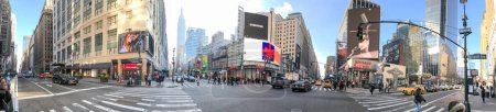 Photo for NEW YORK CITY - DECEMBER 5, 2018: Tourists along Seventh Avenue, panoramic view. The city attracts 50 million people annually. - Royalty Free Image