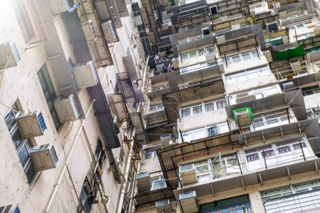 Photo for Run Down Living Quarters in Hong Kong. Crowded Residential Apartments. - Royalty Free Image
