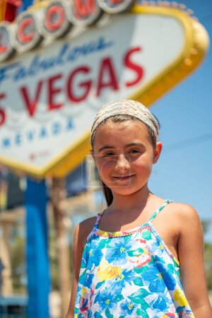 Photo for Happy young girl in front of Las Vegas entrance sign. - Royalty Free Image