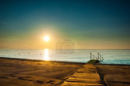 picturesque view of wooden pier on seacoast at sunrise, Turkey