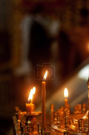 Photo for Burning wax candles in orthodox church - Royalty Free Image