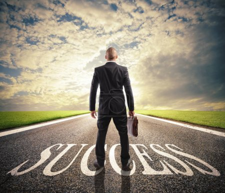 Man walks on a success way. Concept of successful businessman and company startup