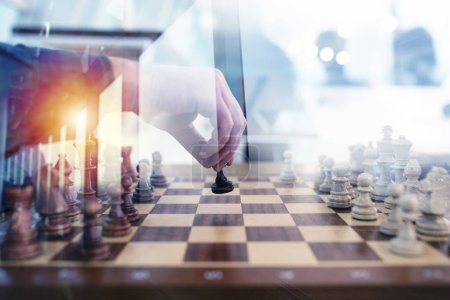 Photo for Business tactic and strategy with chess game and businessmen that work together in office. Concept of teamwork, partnership and challenge. double exposure - Royalty Free Image
