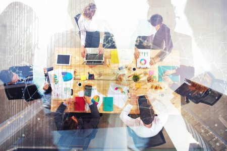 Photo for Business people collaborate together in office. Double exposure effects. Concept of teamwork and partnership - Royalty Free Image