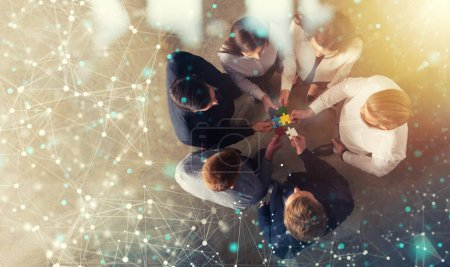 Photo for Business people join puzzle pieces in a modern office. Concept of teamwork and partnership. double exposure with internet network effects - Royalty Free Image