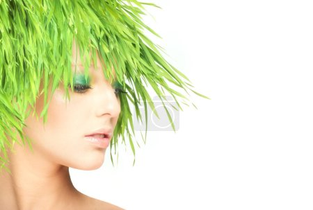 Nature beauty woman with fresh grass hair