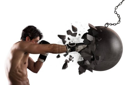 Photo for Self confident man destroys a wrecking ball - Royalty Free Image