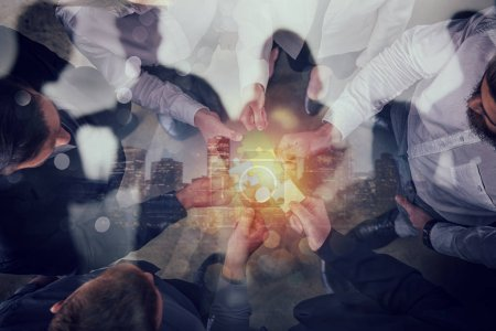 Photo for Business people join puzzle pieces in office. Concept of teamwork and partnership. double exposure - Royalty Free Image