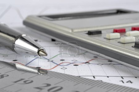 Business background with graph, ruler, pen and cal...