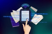 EBook Hand touches the screen of the e-book ��oncept of using