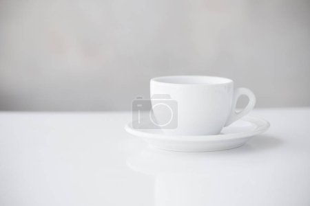 Photo for White cup on table - Royalty Free Image