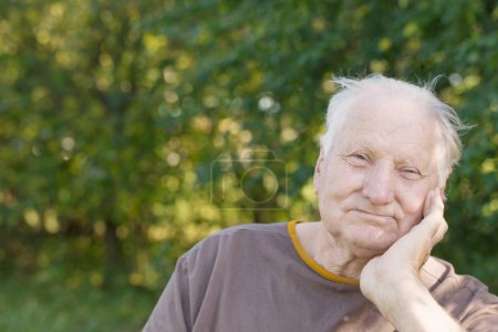 Photo for Portrait of  elderly man in sunny park - Royalty Free Image