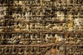 """Постер, картина, фотообои """"Рельефы на поверхности стены старого древнего храма. Абстрактный фон"""""""