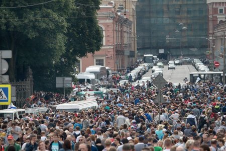 Saint Petersburg, Russia - July 30, 2017: Huge crowd of people during holiday, city festivals, urban entertainment, townspeople gathered on historic street, mob stormed through streets
