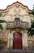 Detail of the portal, balcony with balusters and unfinished coat of arms of the austere baroque Manor of the Viscount of Almendra, on June 20, 2018 in Almendra, Portugal