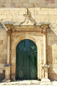 Detail of the side facade portal of Mannerist Church of Our Lady of the Angels in Almendra, Portugal