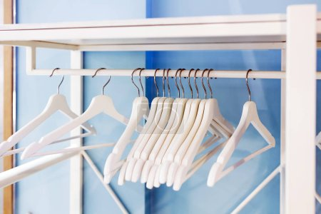 Photo for White hangers in the empty wardrobe - Royalty Free Image