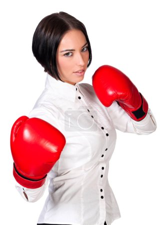Pretty business woman wearing red boxer gloves, isolated on white background