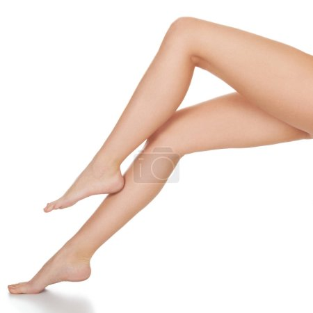 Photo for Beautiful long female legs, unwanted hair removal concept. Skin care. White background, isolated - Royalty Free Image