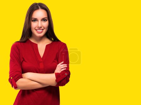 Photo for Young pretty woman posing against yellow background isolated. Happy student girl - Royalty Free Image