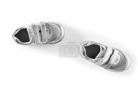 flat lay, silver children's sports shoes isolated on a white background