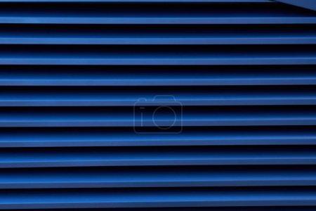 Close-up image of a blue metallic profile pattern.