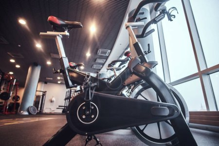 Photo for Exercise bikes in the fitness center. Sport, fitness, health - Royalty Free Image