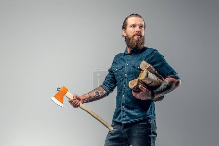 Portrait of attractive lumberjack at photo studio