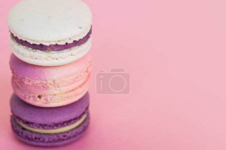 Photo for Pyramid of bright colored macaroni cakes. Sweet dessert, delicious French cookie. - Royalty Free Image