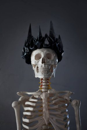 Skull in the crown. Grim necromancer in Gothic crown.  Halloween concept