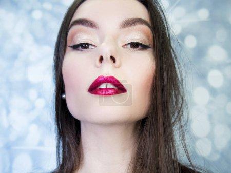 Young beautiful brunette woman portrait close-up, bright makeup