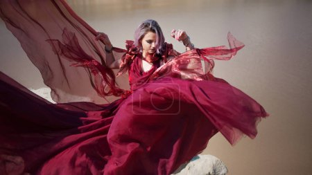 Lady in red. Young beautiful woman, delightful portrait in red flying dress