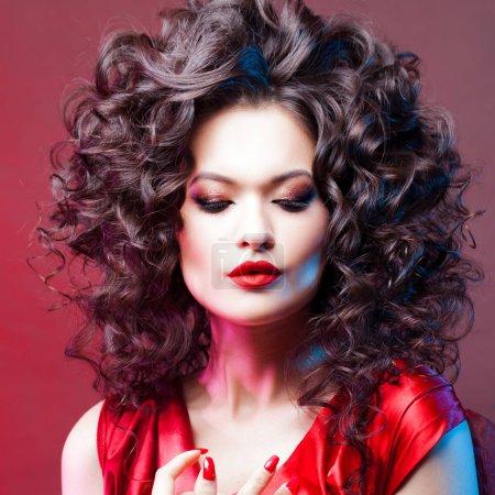 Big hair. Voluminous curls.