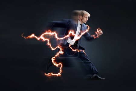 Photo for Fast business. Running businessman charged with lightning, concept. black background - Royalty Free Image