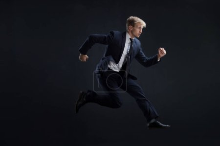 Fast business. Running businessman in business suits, concept