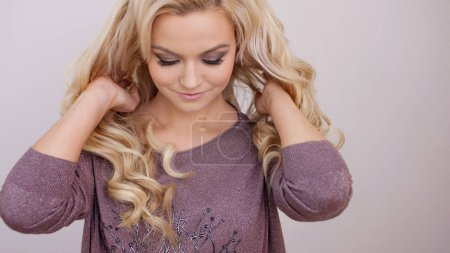 Photo for Portrait of beautiful blonde young woman with long luxurious curls. Beautiful and healthy hair, care and coloring - Royalty Free Image