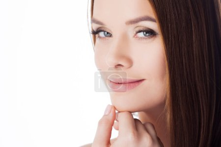 Photo pour Skin care. The girl touches her face, close-up. Portrait of young beautiful woman with smooth and healthy skin isolated on white - image libre de droit