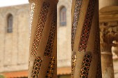MONREALE, SICILY - NOV 28, 218 - Inlaid marble mosaics on slender columns of the cloister of Cathredral Monreale, Sicily, Italy