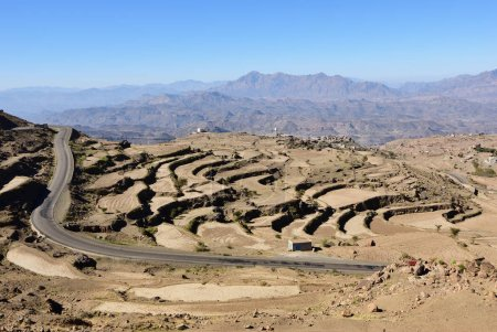 Countryside landscape of Yemen. Tar road and rocks cut by agricultural fields