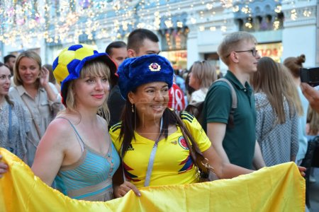 Moscow, Russia - June 23, 2018: Colombian and russian girls  football fans on the streets of Moscow. Soccer fans from abroad walking down the Nikolskaya streets in Moscow, FIFA world cup, Mundial 2018