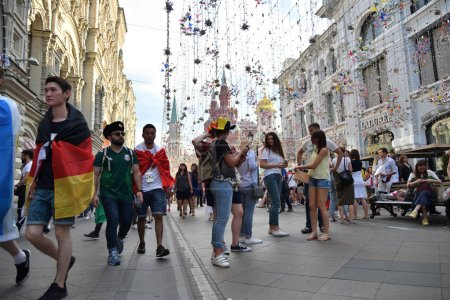 Moscow, Russia - June 23, 2018: Football fan from different countries on the streets of Moscow. Soccer fans from abroad walking down the Nikolskaya streets in Moscow, FIFA world cup, Mundial 2018