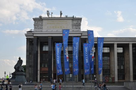 Moscow, Russia - June 23, 2018: Building of the Russian State Library former Lenin's Library, the metro station with the same name and welcoming banners of the FIFA World Cup 2018 with  wolf Zabivaka