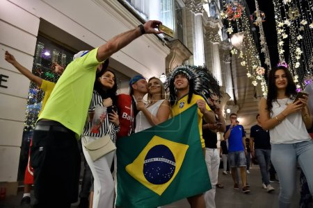 Moscow, Russia - June 26, 2018: Brazilian and russian football fans on the night streets of Moscow. Soccer fans from abroad walking down the Nikolskaya streets, FIFA world cup, Mundial 2018