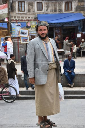 Sanaa, Yemen - March 6, 2010: Street scene in capital of Yemen. Yemeni man shown at the street in Sanaa. Among other arabic countries, in 2012 Yemen became a site of civil conflicts